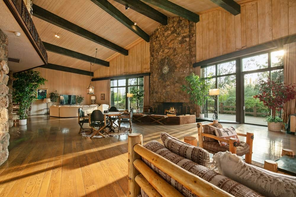 This is another view of the hall that houses three different living room areas under one tall beamed ceiling. Image courtesy of Toptenrealestatedeals.com.