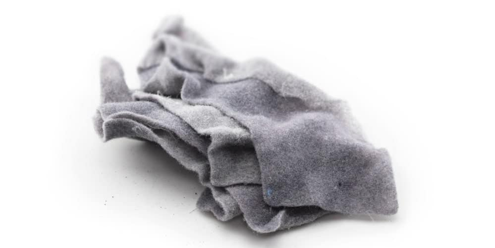 A close look at a gray dryer lint collection.
