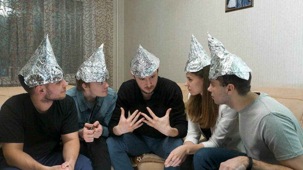 A group of friends wearing tin foil hats.