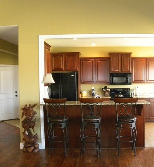 Round counter chairs complement the granite top peninsula.