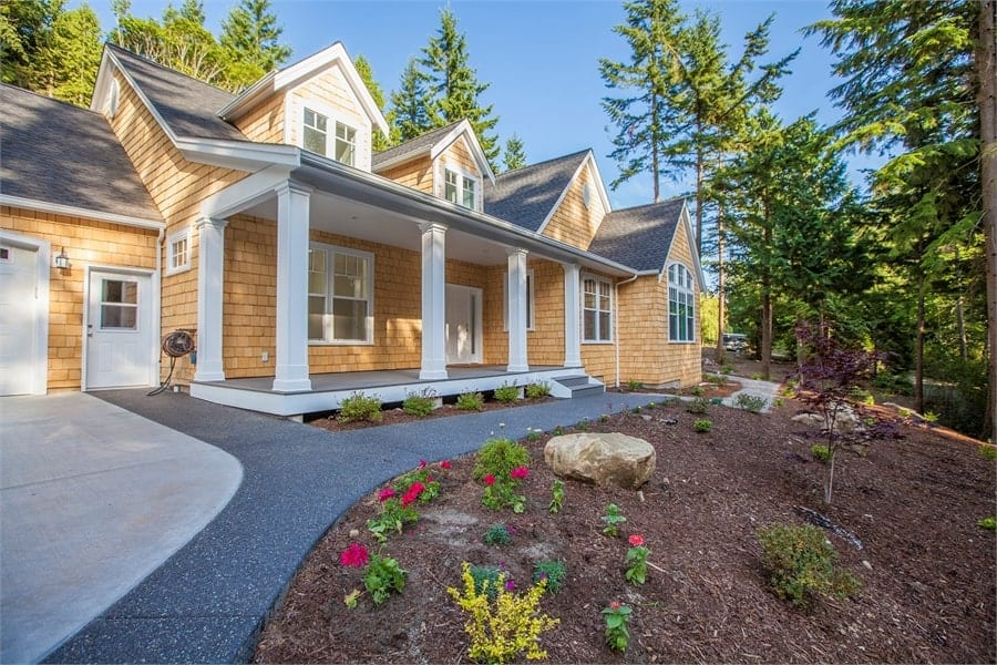 Single-Story 4-Bedroom Cape Cod Style Home with Three-Bay Garage