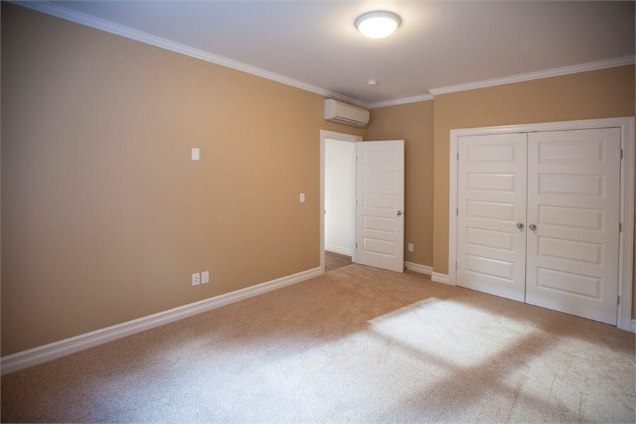 The other side shows a white double door that reveals the walk-in closet.