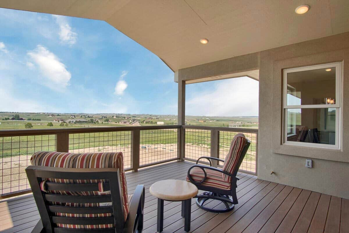 The vaulted deck has a breathtaking view of the expansive surrounding.