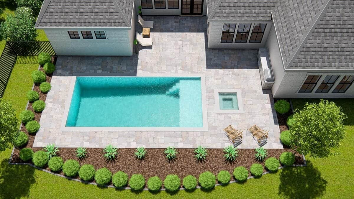 Top view of the home's backyard showing the pool deck and the lush landscaping.