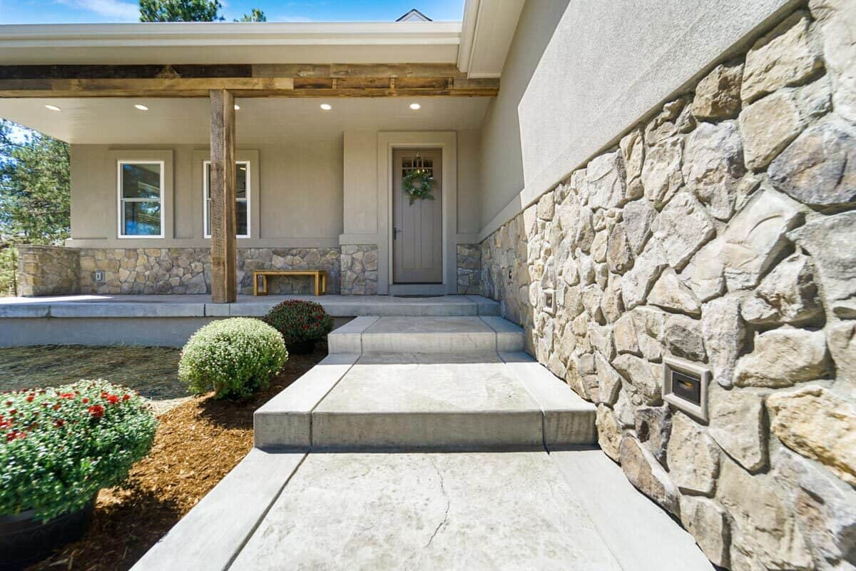 A close-up look at the concrete stoop leading to the entry porch.