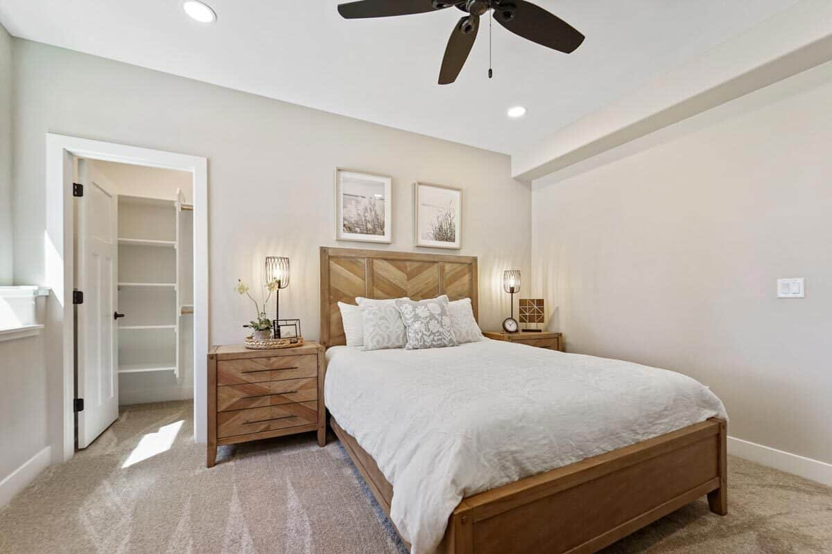 The bedroom includes a walk-in closet enclosed in a white door.