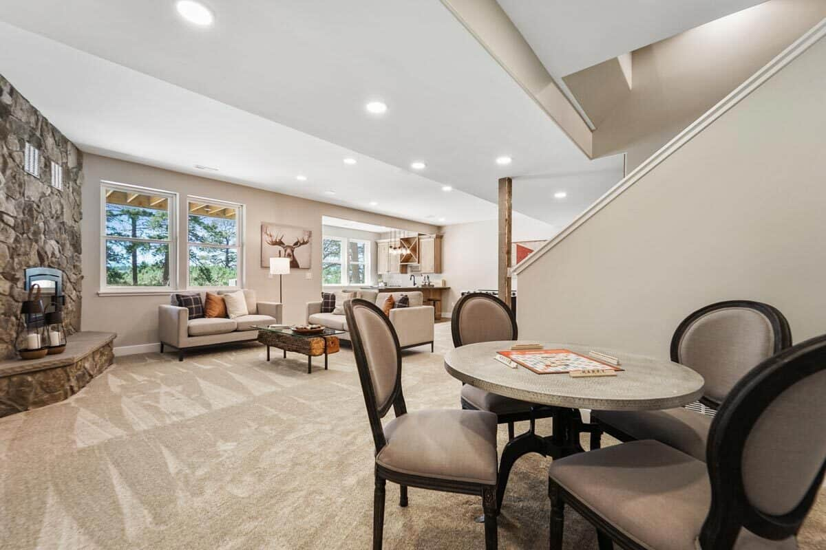 The recreation room offers casual dining featuring a round table and matching chairs.