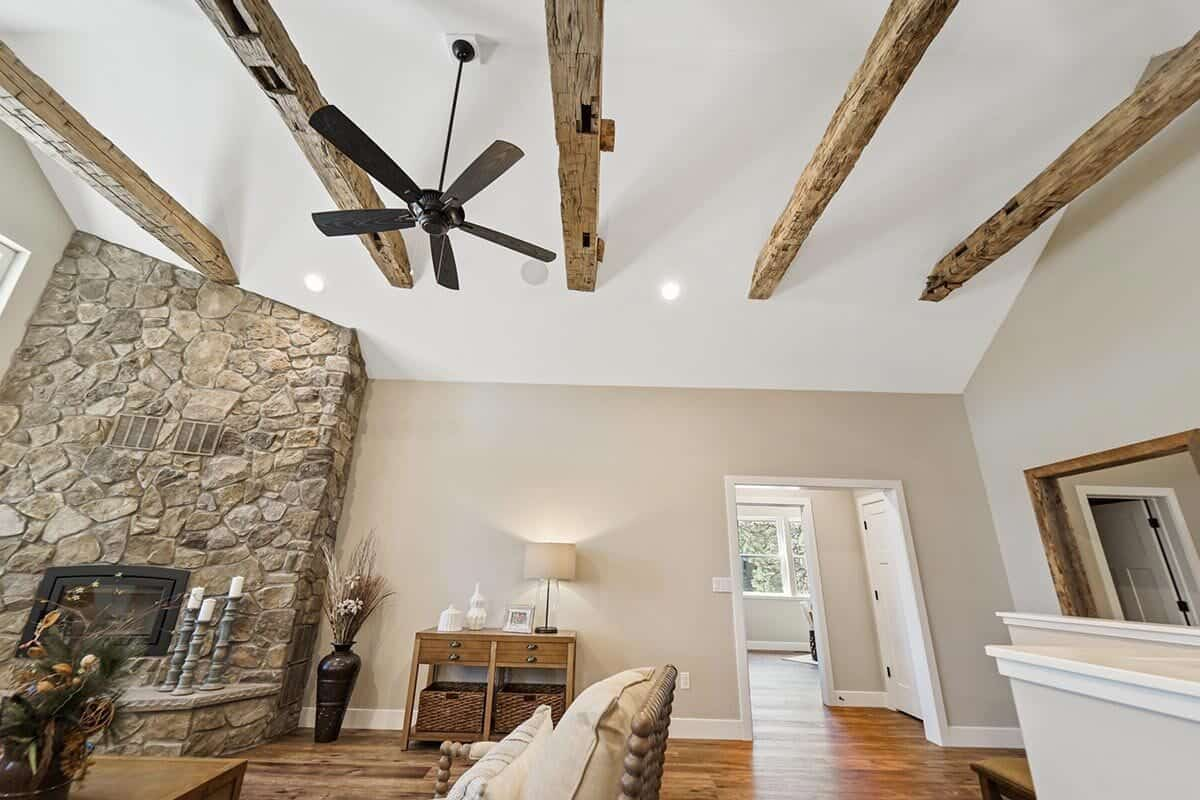 A close-up look at the rustic wood beams lining the vaulted ceiling.