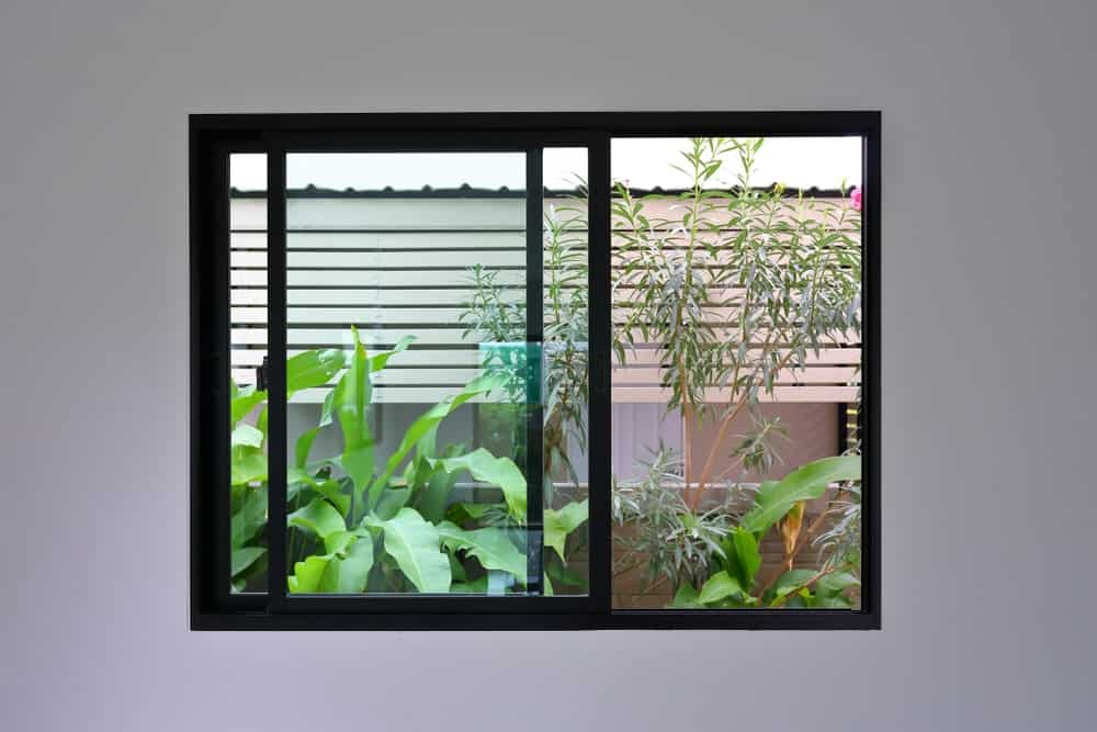 A set of sliding windows opening up to the garden.