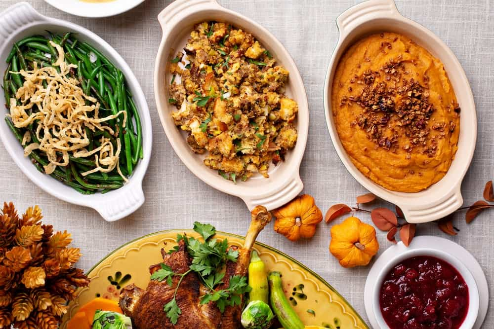 A close look at the traditional side dishes of a thanksgiving dinner.