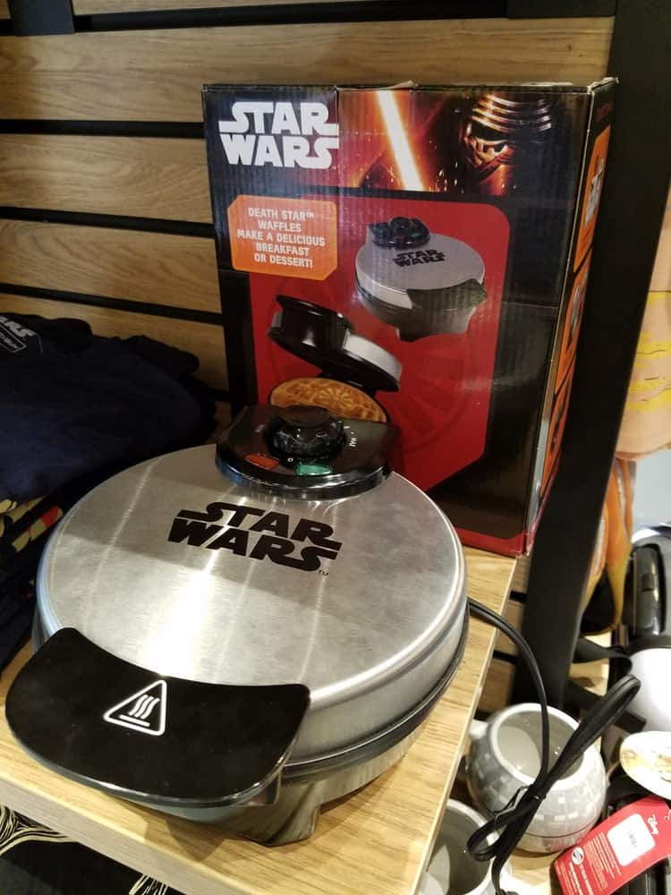 A close look at a Star Wars Death Star waffle maker on display.