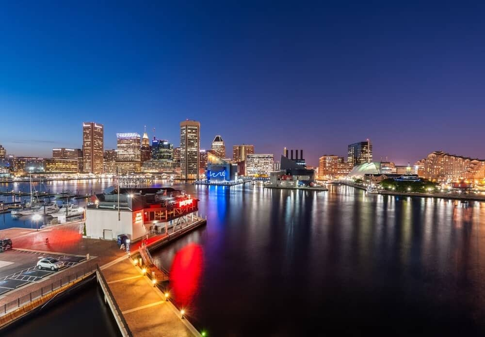 This is a nighttime aerial view of the whole area showcasing the lights of the city view and the water scenery. Image courtesy of Toptenrealestatedeals.com.