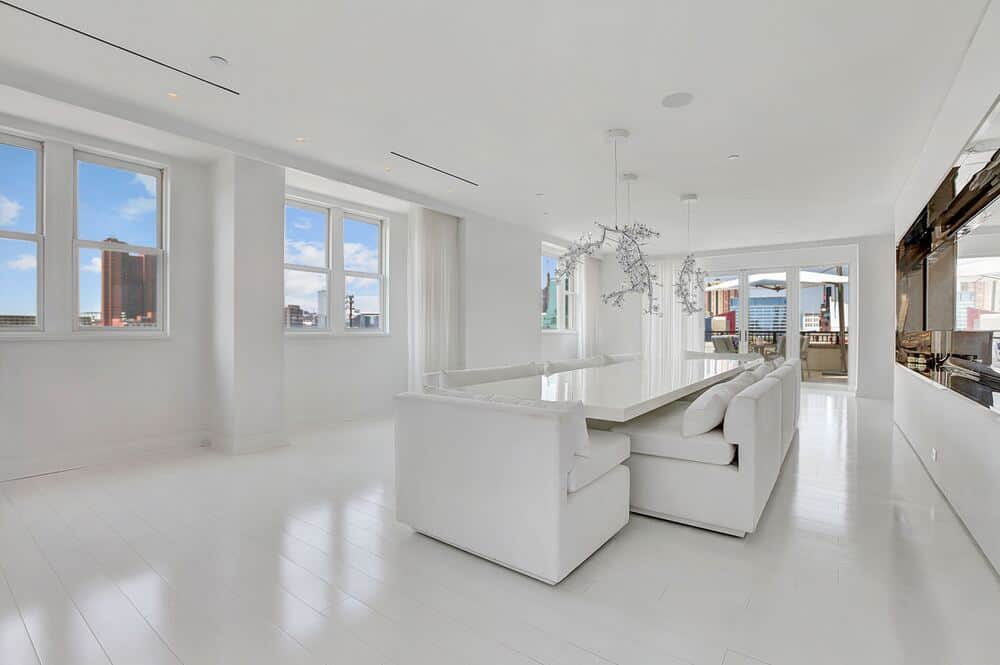 This is the spacious and bright dining room with a consistent white tone to its walls, floor, ceiling and the dining set. Image courtesy of Toptenrealestatedeals.com.