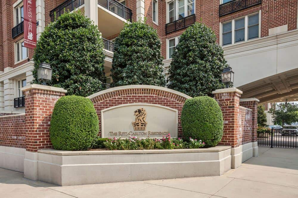 This is a close look at the landscaping and name of the building where the penthouse is located. Image courtesy of Toptenrealestatedeals.com.