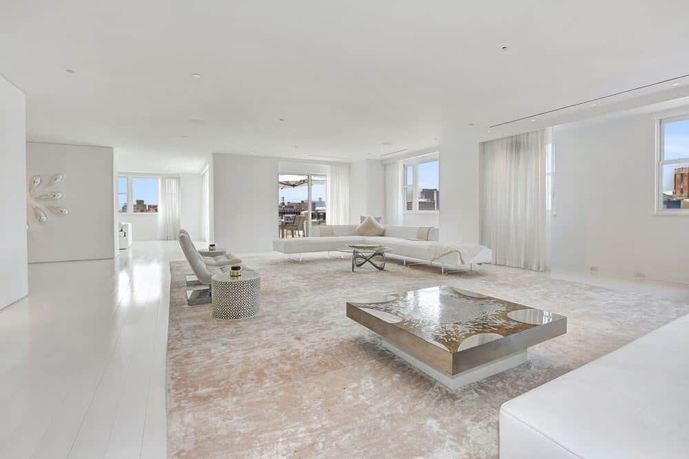 This is the other side of the living room with another set of L-shaped sofa paired a large coffee table and end tables. Image courtesy of Toptenrealestatedeals.com.