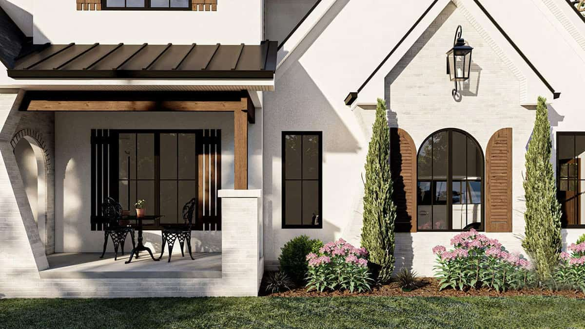 The front covered porch is framed with wooden trims and a tapered column.