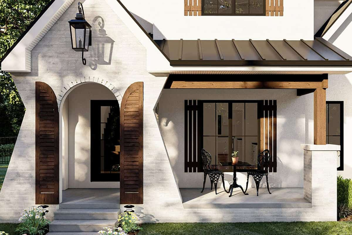 Home entry with an open archway adorned with exterior shutters and an outdoor sconce.Home entry with an open archway adorned with exterior shutters and an outdoor sconce.
