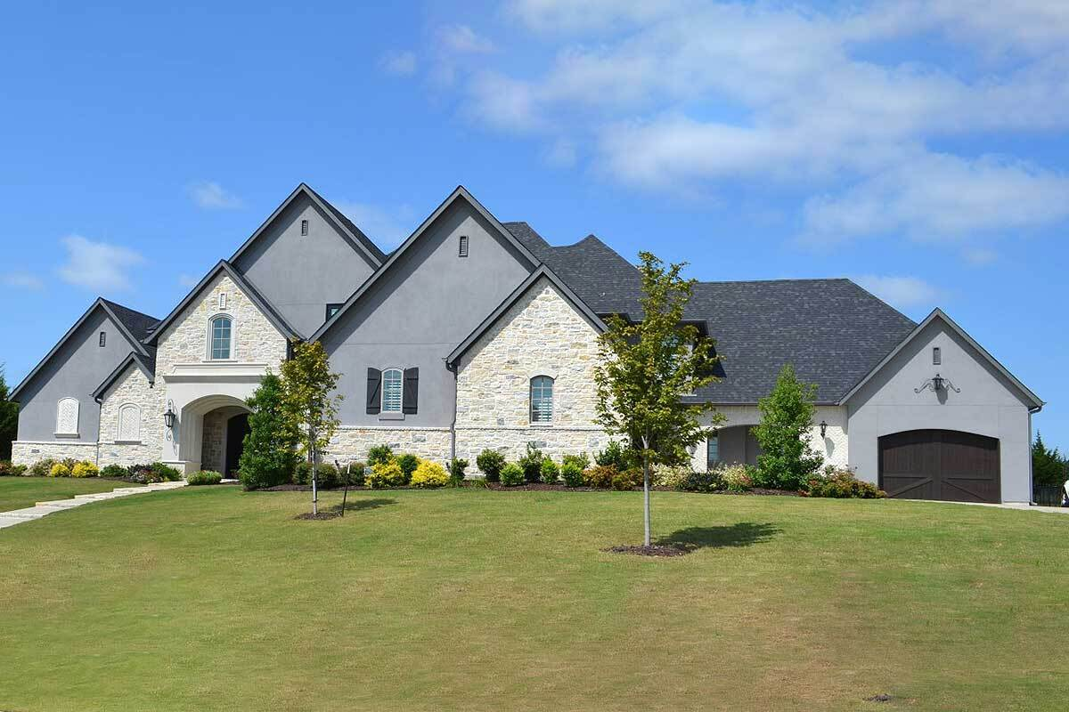 Two-Story 4-Bedroom Traditional Home with 4-Car Garage and Storage Elevator