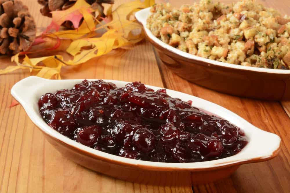 A bowl of cranberry stuffing at a Thanksgiving table.