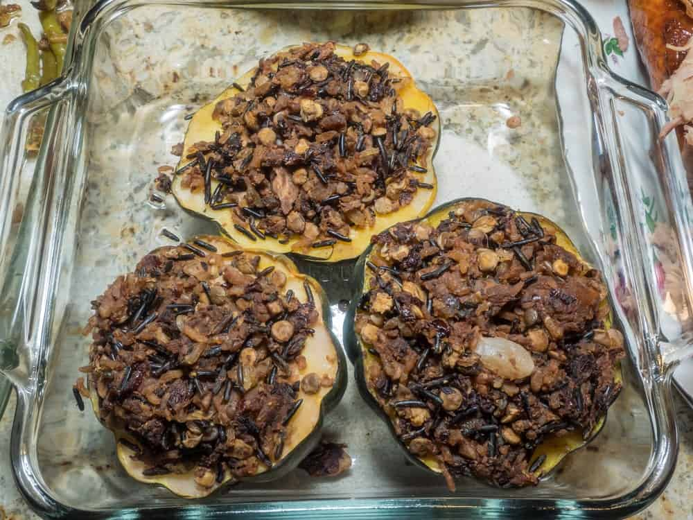 This is a close look at baked pumpkin with wild rice stuffing.