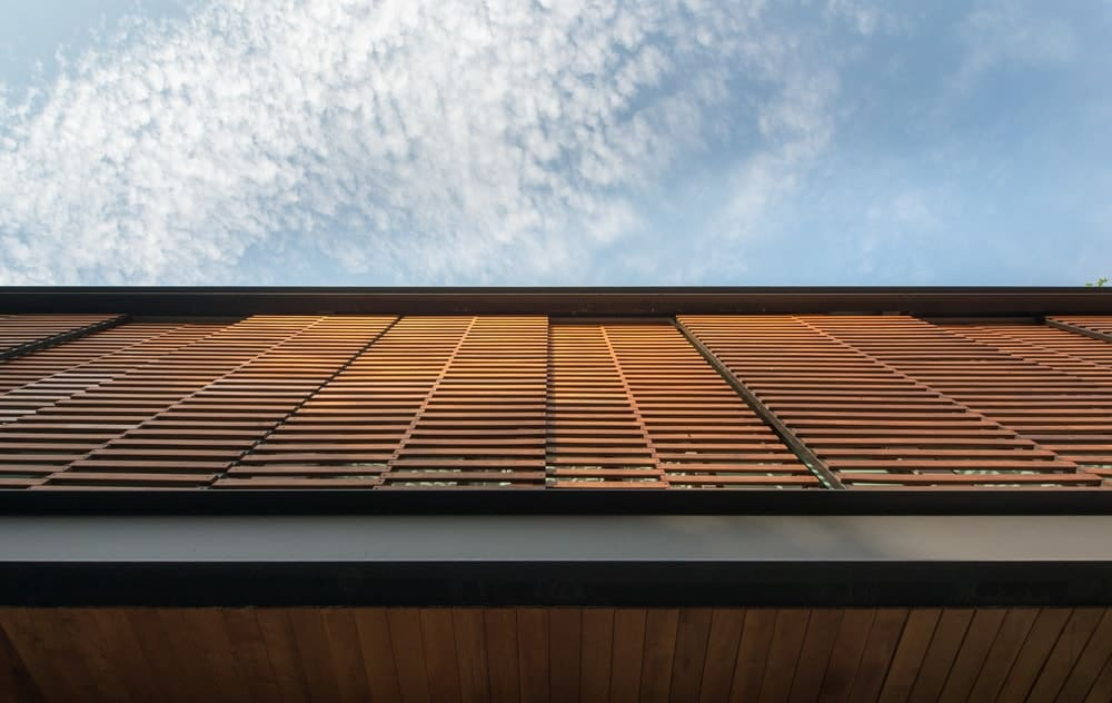 This is a close look at the wooden slats of the second floor balcony that can also be retracted to let in more light.
