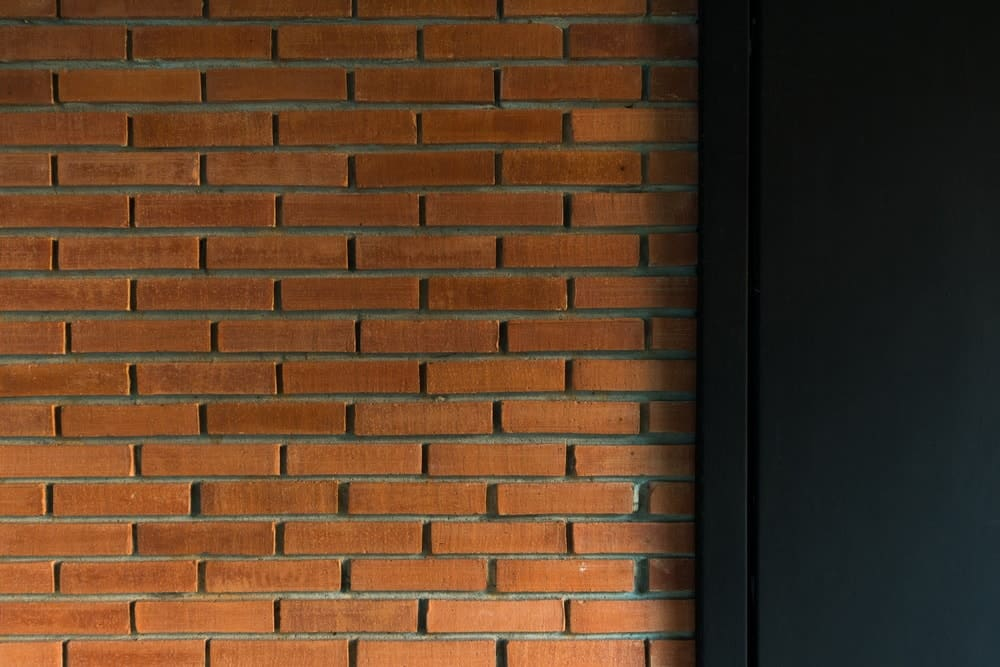 This is a close look at the red brick wall of the dining room that gives it a unique look.