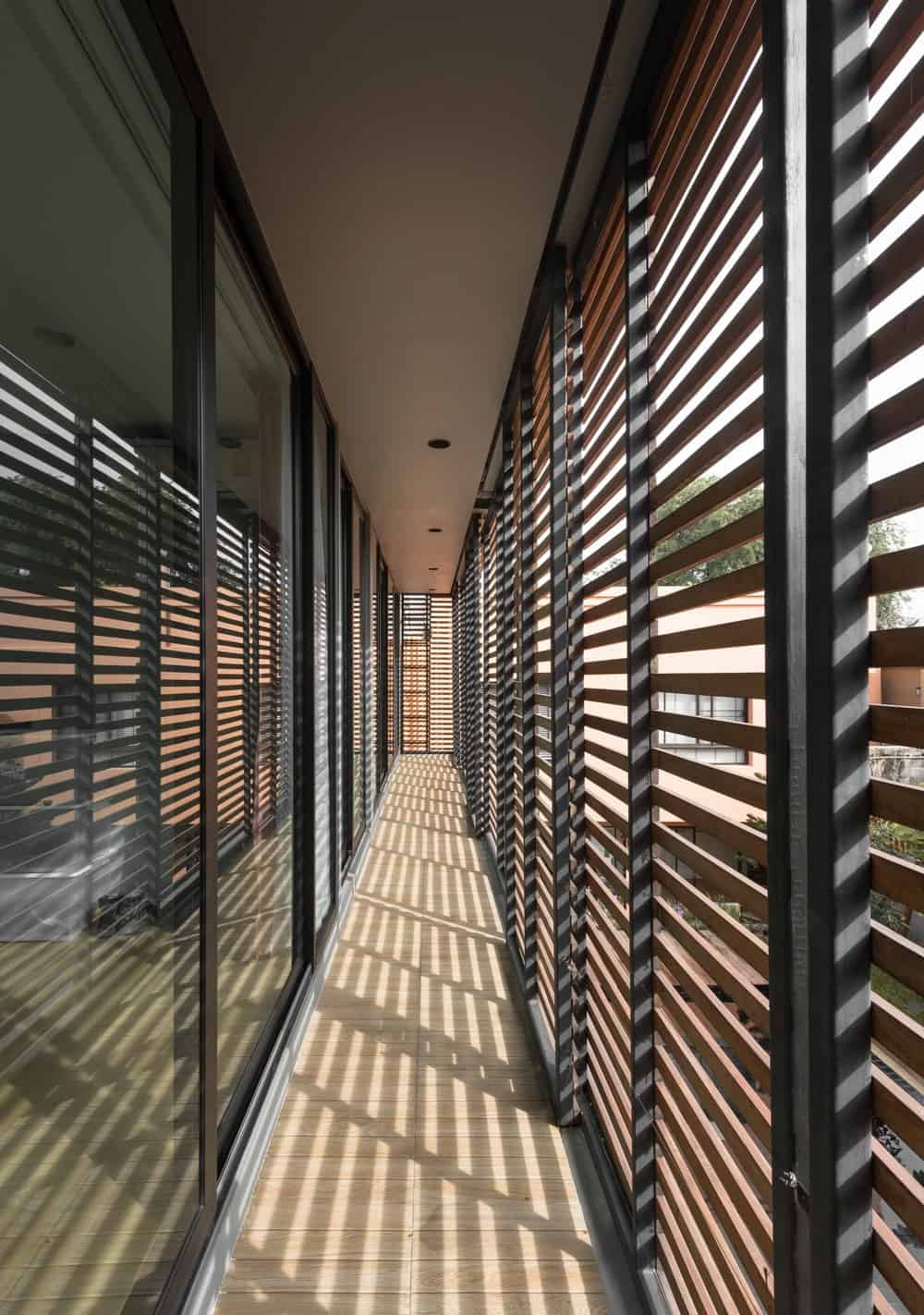 This is the walkway on the side of the second floor beyond the glass walls that also serve as a balcony.