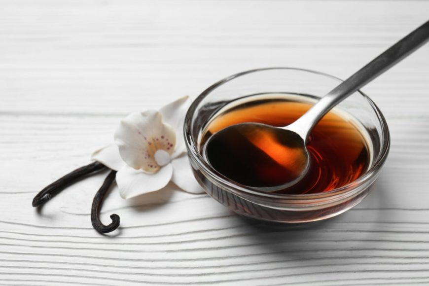 A small glass bowl of vanilla extract.