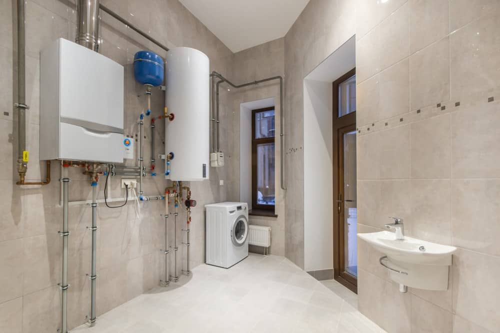 A look at the laundry room of the house with a heat pump water heater system.