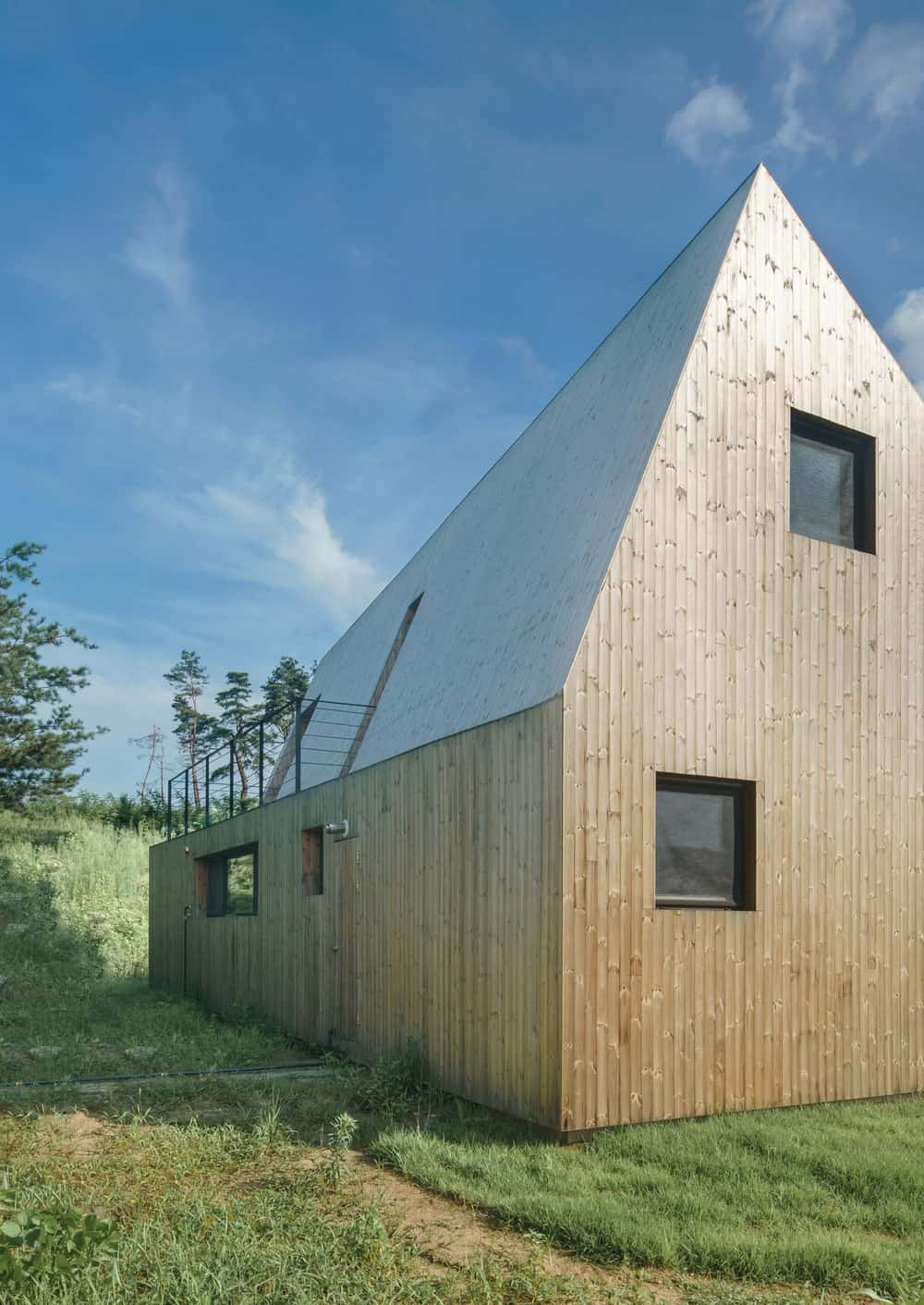 This is a close look at the simple and small windows of the house with wooden exterior walls.
