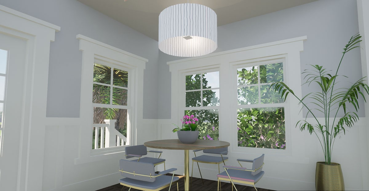 Dining area with gray contemporary chairs and a round dining table well-lit by a drum chandelier.