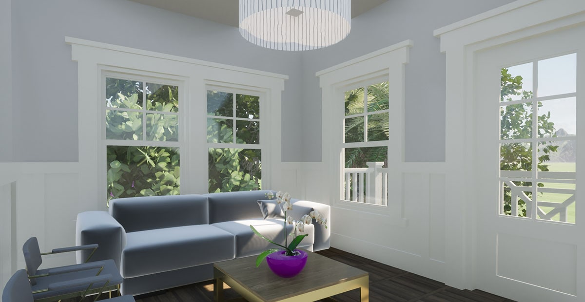 The living room has gray seats, a wooden coffee table, and glass windows overlooking the outdoor scenery.