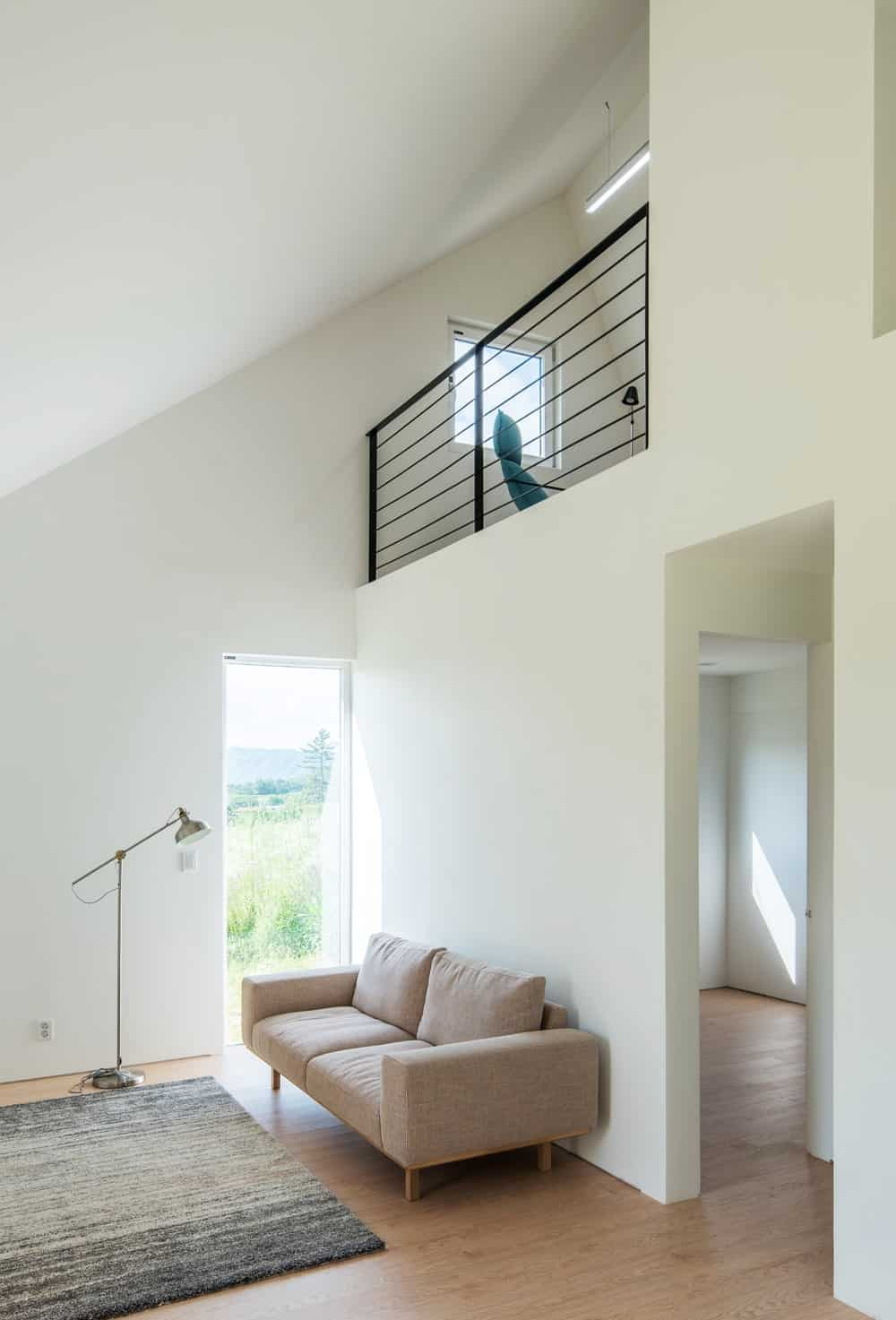 This look at the living room showcases the wrought iron railings that stand out against the bright walls.