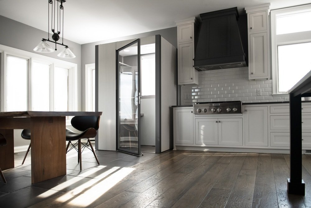 The home office pod has white walls and gray frames to match the aesthetic of the kitchen.