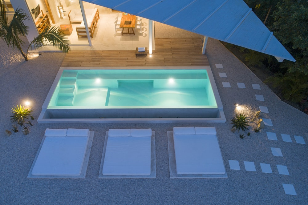 This is an aerial view of the swimming pool during nighttime showcasing the ethereal glow of the pool.