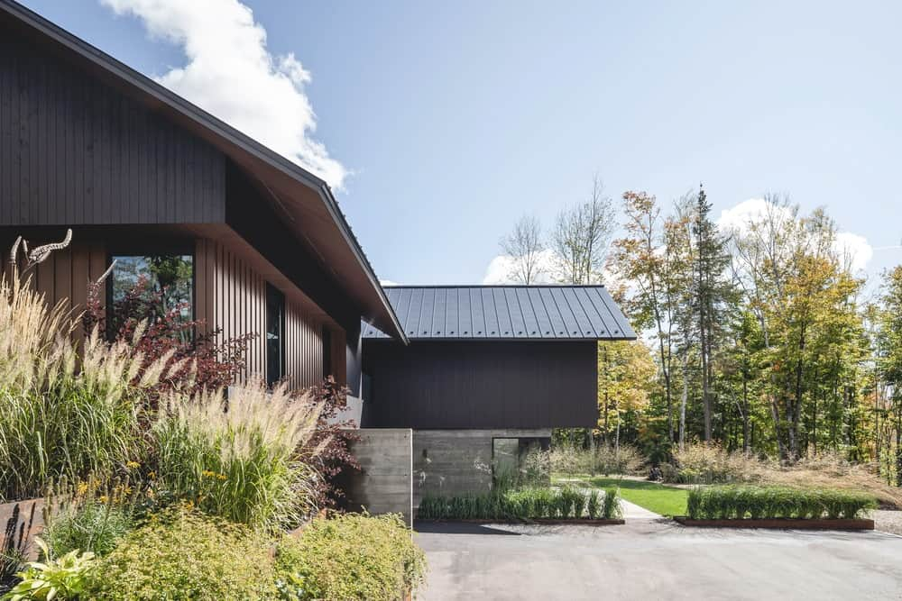 This side of the house showcases the three tones of the exteriors with dark wooden walls and concrete base.