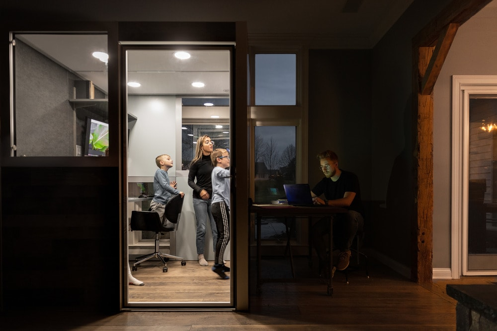 The large home office pod also works as a classroom for the kids of the house with a whiteboard on the wall.