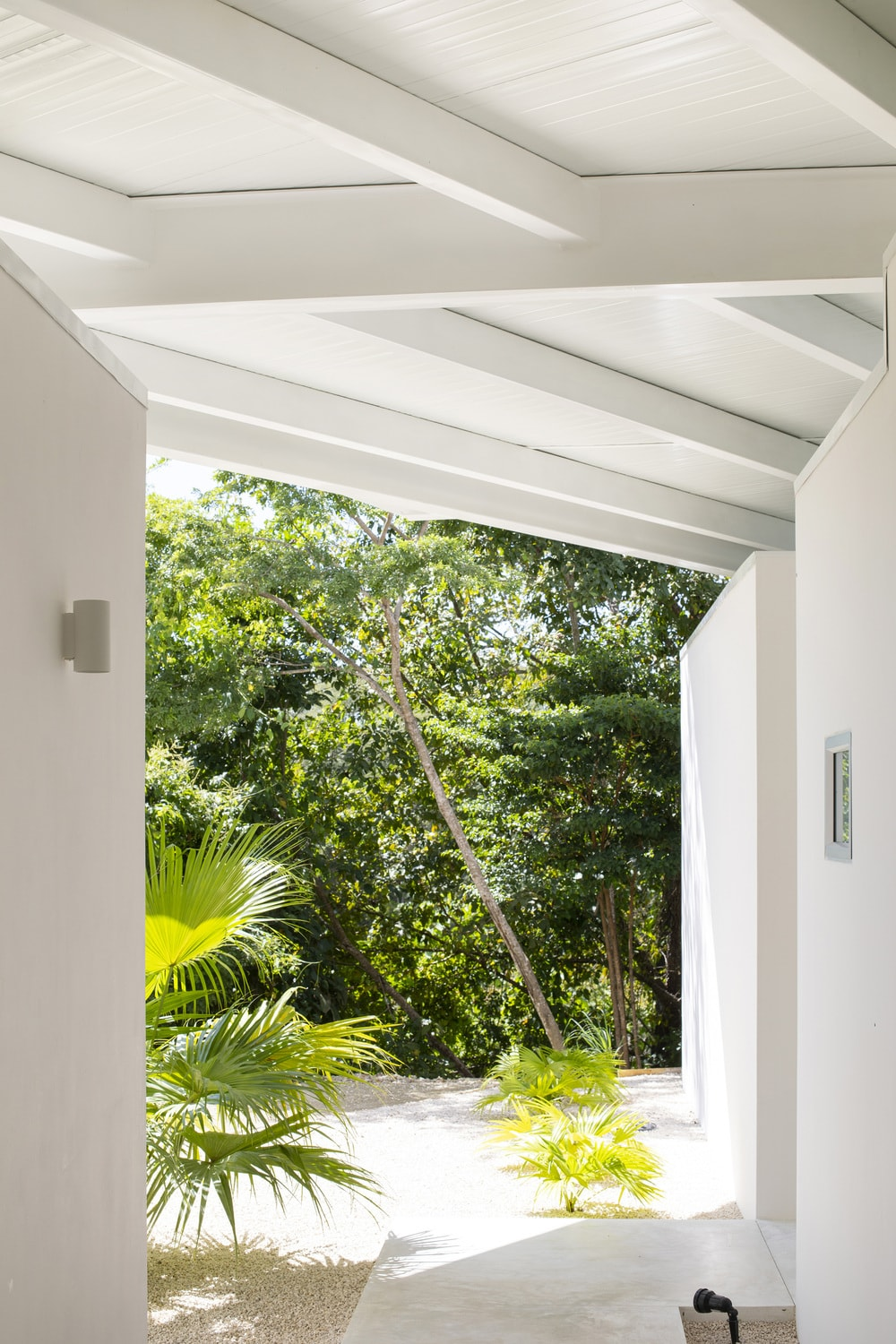 This is a covered walkway within the property with a clear view of the surrounding landscape.