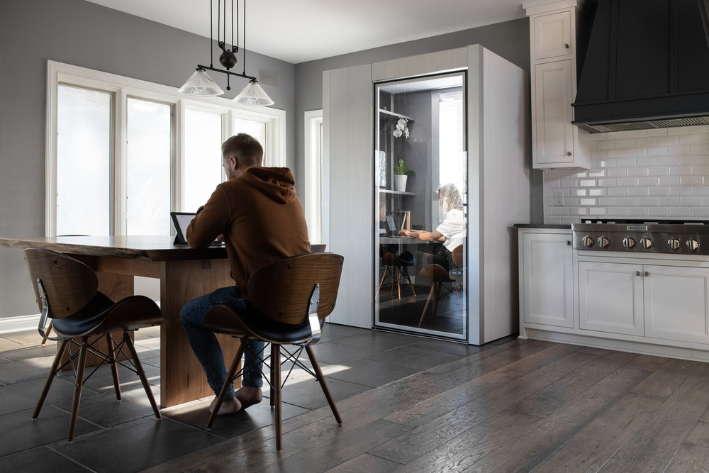 This is an office pod that is placed in the corner of the kitchen near the dining table.