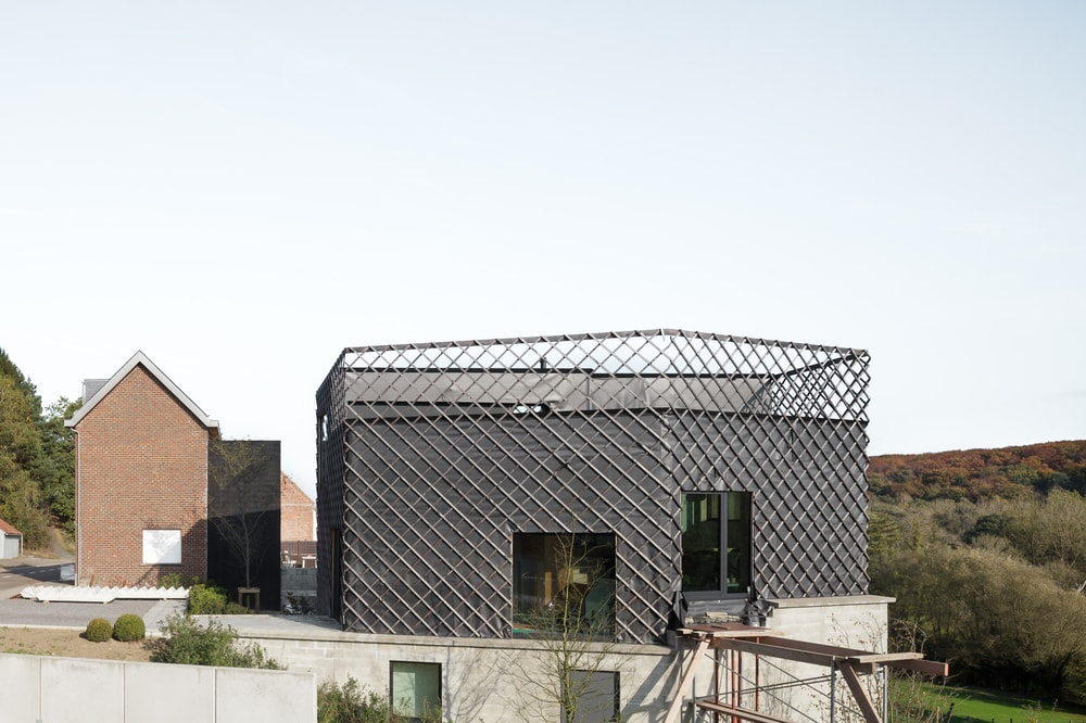 This closer look at the house showcases the unique design of the patterned railings that runs from the balcony to the rest of the house exterior walls.