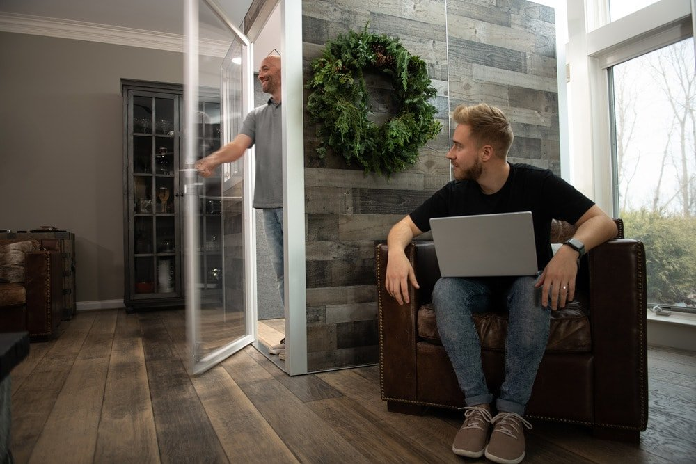 The office pod has a glass door with a frame that glows when the lights are on inside.