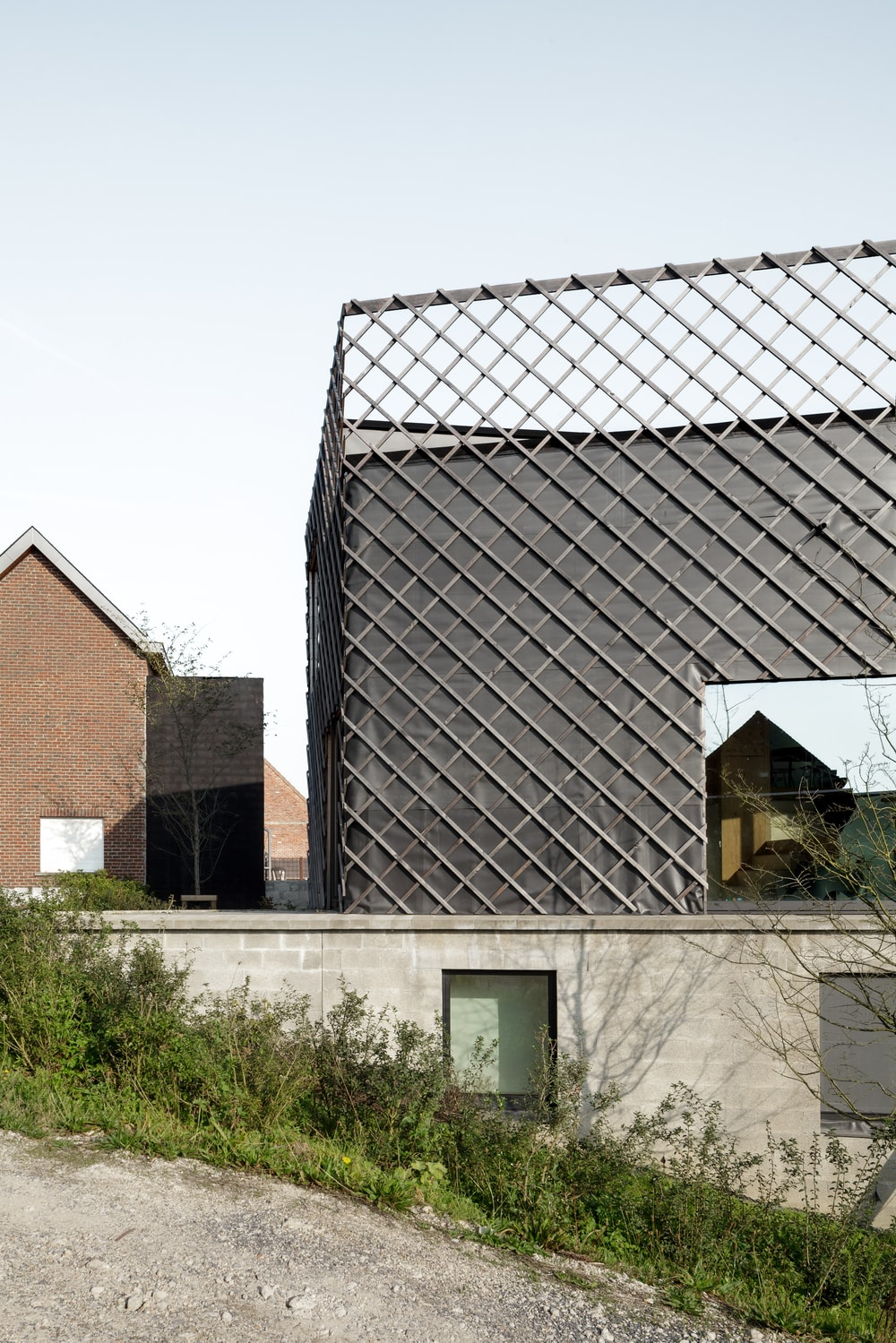 This closer look at the house features more of the patterned railings and how it extended to be a design for the exterior walls for a unique texture.
