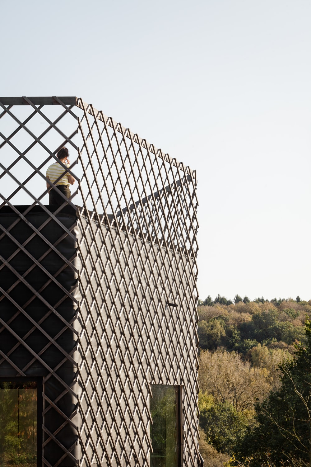 This is a closer look at the balcony at the top of the house where the metallic patterned panels of the exterior extend to serve as railings.