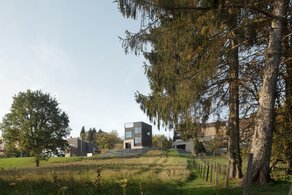 This is a view of the house from a distance showcasing the surrounding area and landscape.