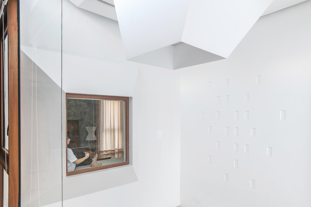 This is a close look at the exterior of the window with a reading nook.