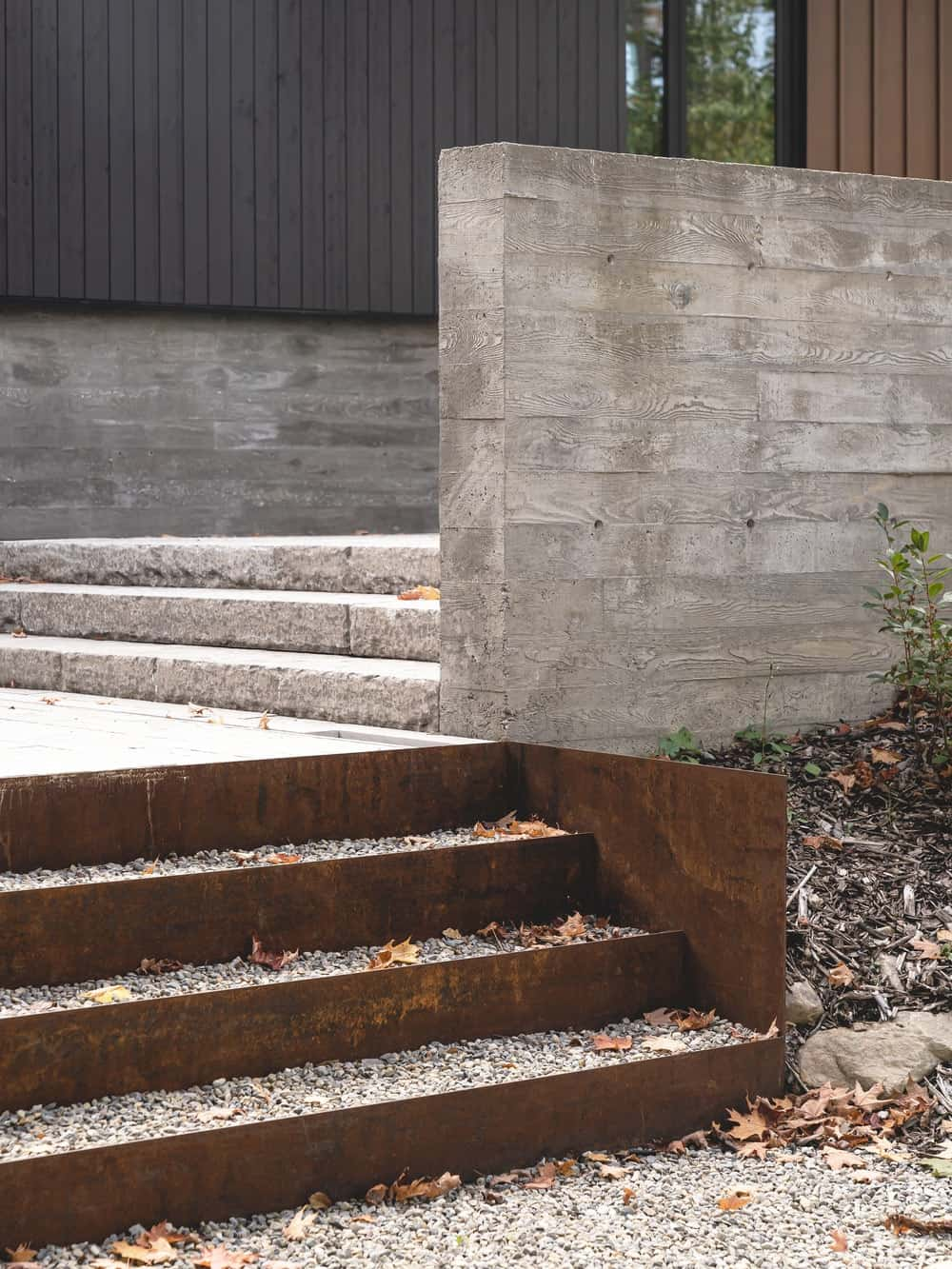 This is a close look at the concrete steps leading from the courtyard to the main entrance of the house.