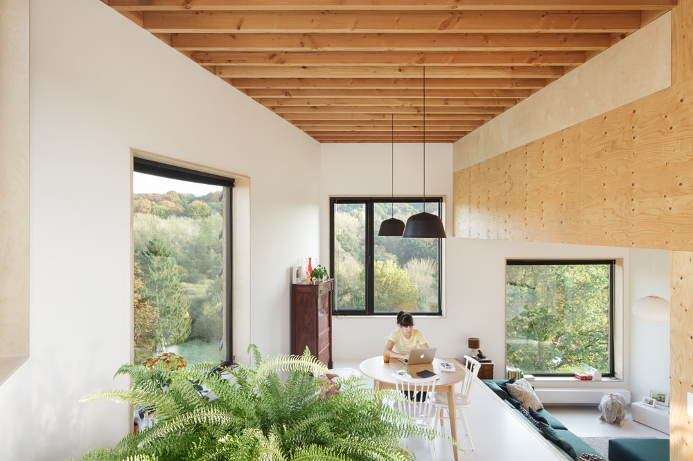 This view of the house showcases both the dining area and the living room area and their proximity to each other.
