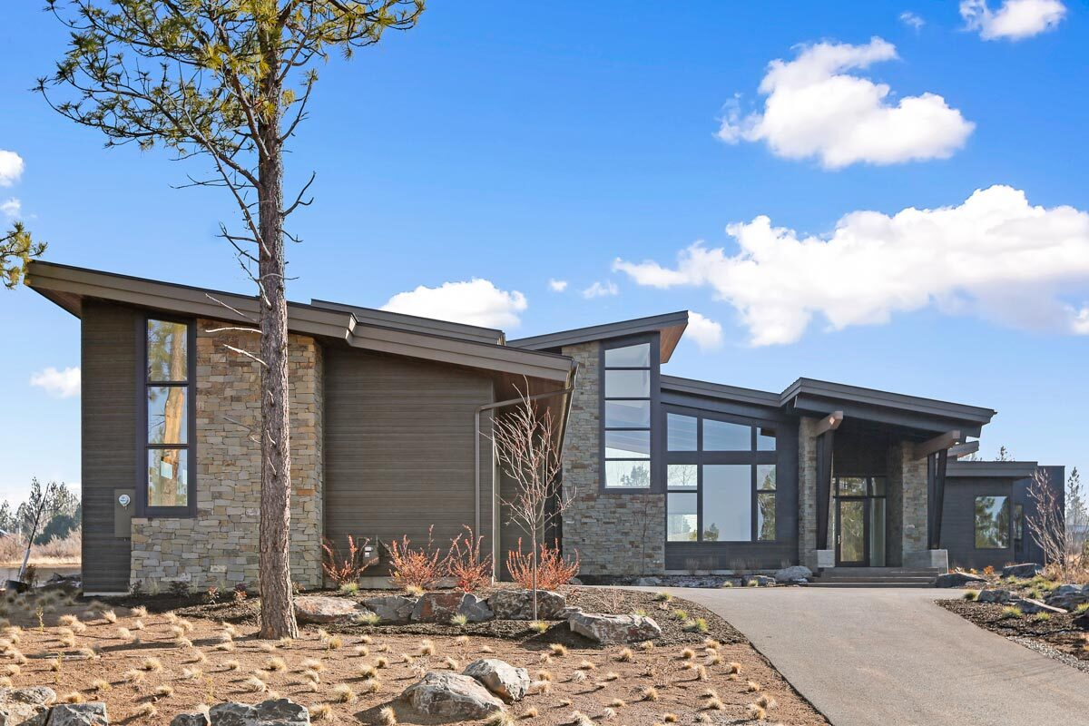 A concrete driveway leads to the home entry and oversized garage.