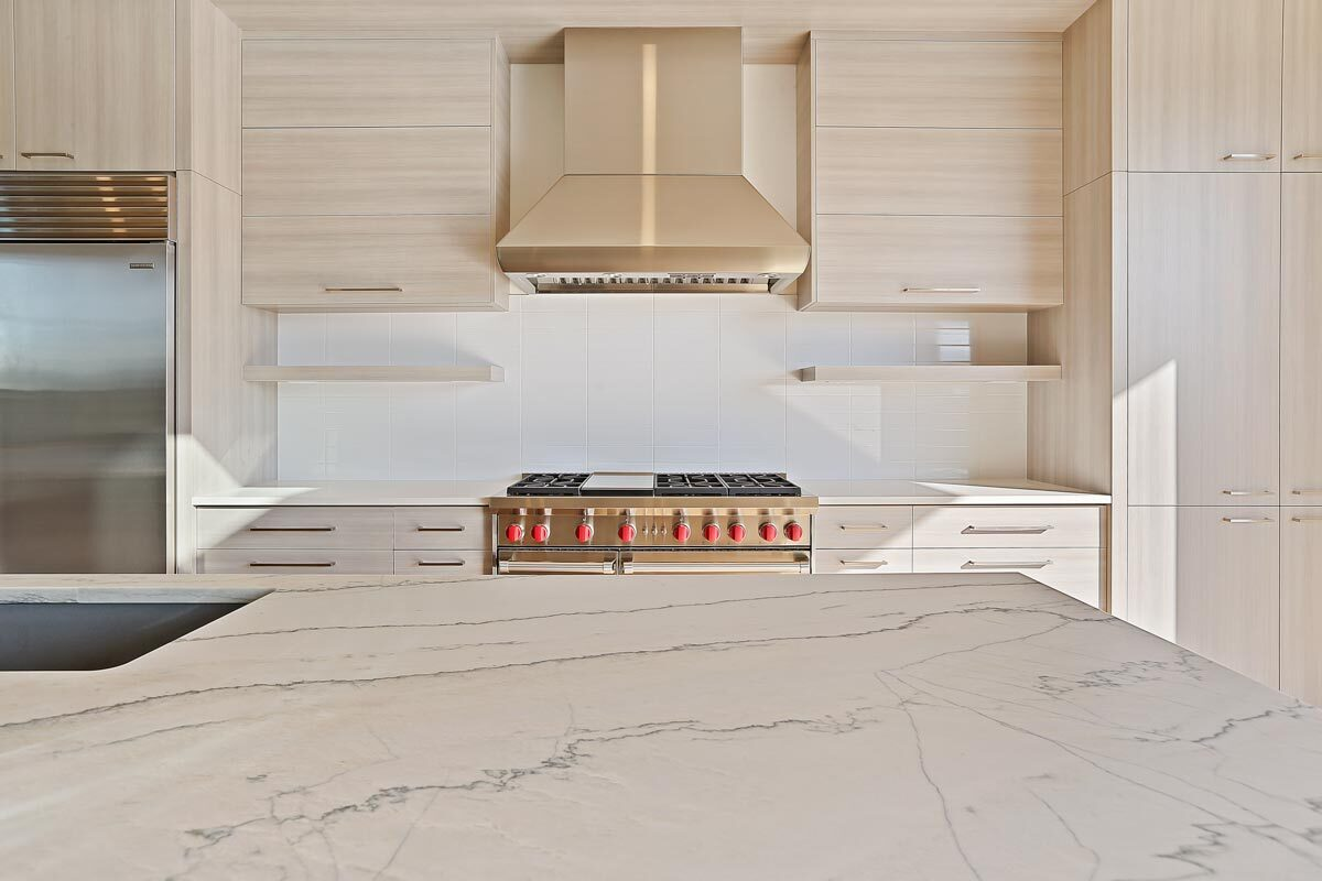 A close-up look at the marble countertop sitting across the cooking range.