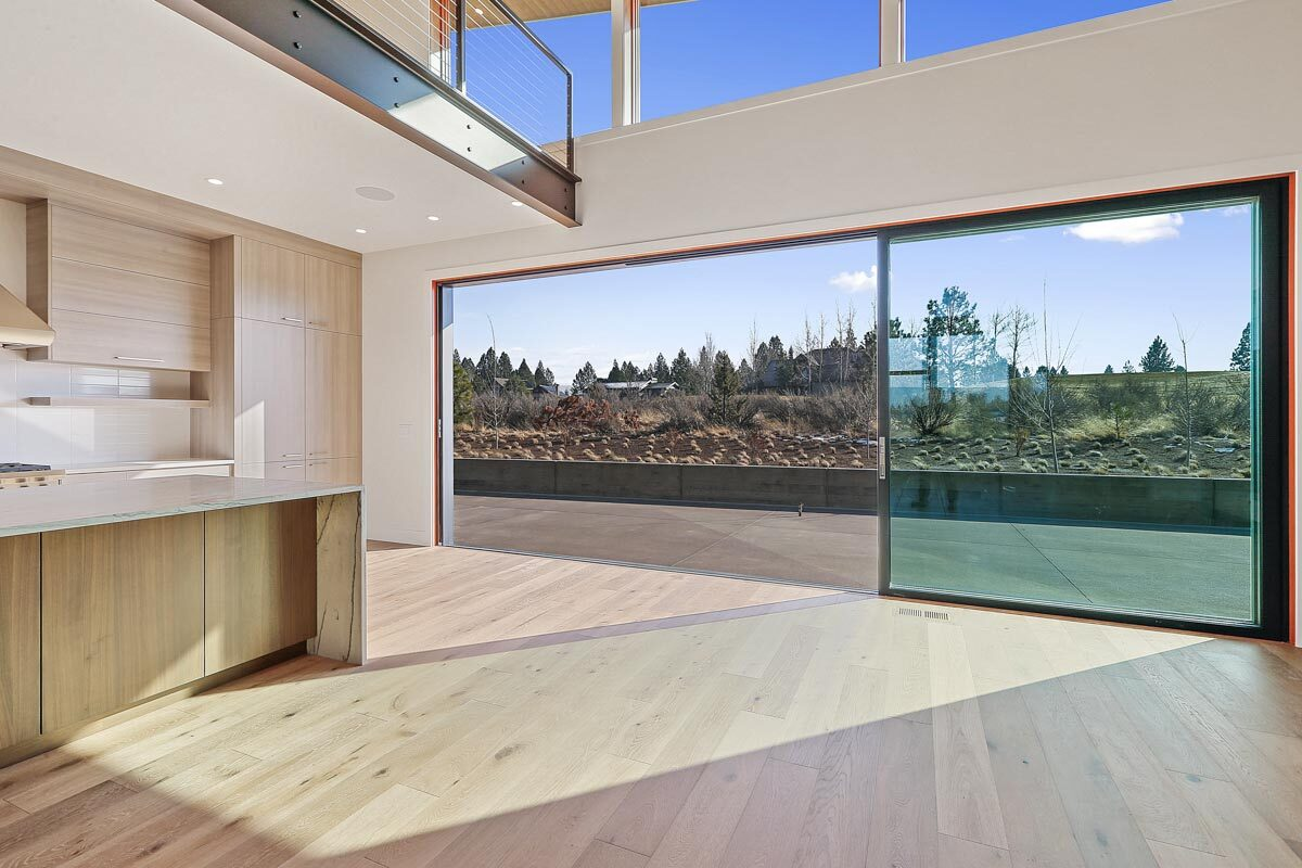 A large sliding glass door in the kitchen opens to the rear patio.